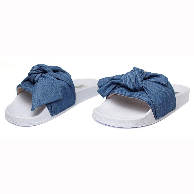 Chinelo convexo slide com no jeans 1